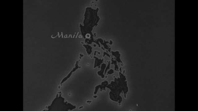 map of philippines with manila marked / fade to map of manila area / aerial shot of manila smoke rising / map of manila area with rosario... - isola di luzon video stock e b–roll
