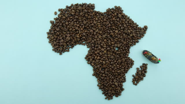 Map of the Africa made of roasted coffee beans, import-export concept