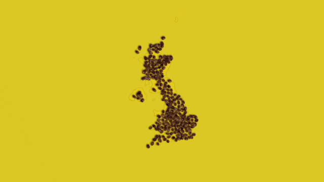 map of united kingdom created from coffee beans on a yellow background - conservative party uk stock videos & royalty-free footage