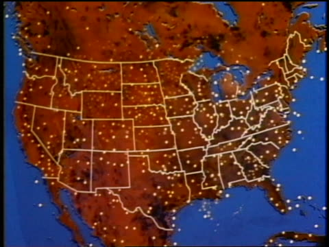 1975 ANIMATED map of United States with flashing lights fading in to wide shot of globe with flashing lights