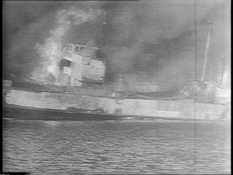 map showing bari harbor and the balkans / german planes bombing the port city of bari / allied navy ships aflame in bari harbor after being bombed on... - anno 1943 video stock e b–roll