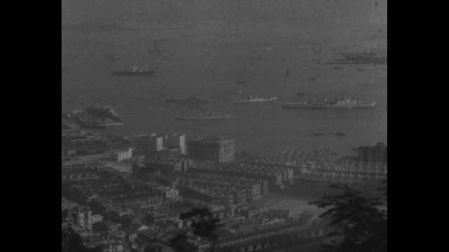 map showing triangle connecting ports of tokyo manila and pearl harbor and distances between them / birdseye view of section of hong kong by the sea... - 1940 stock-videos und b-roll-filmmaterial