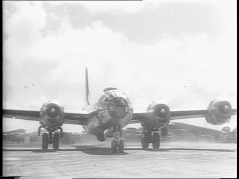 map zeroes in on saipan / wide high angle shot of camp / wide shot of b-29 landing on airstrip / medium shot of soldiers standing on tarmac / map... - b29 stock videos & royalty-free footage