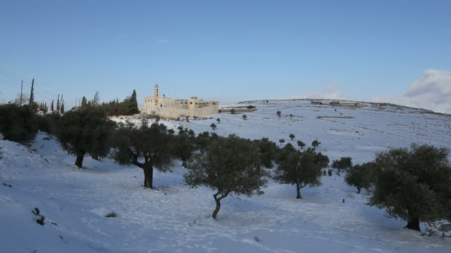 mar elias monastery with olive trees in winter snow, jerusalem - monastero video stock e b–roll