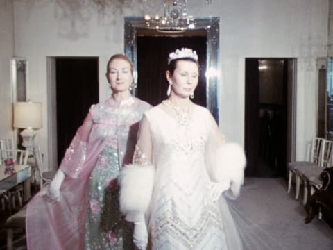 vídeos y material grabado en eventos de stock de mara levy and jane chorley wear heavily embroidered evening gowns with diaphanous coats designed by norman hartnell - translúcido