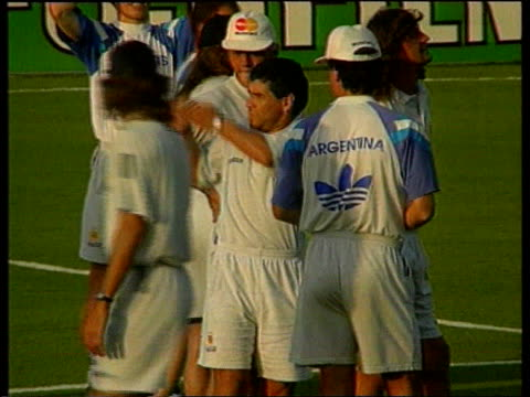 maradona indefinate ban; itn lib ext maradona on pitch talking to other argentinian players side maradona l-r as along with others int argentina... - fifa stock videos & royalty-free footage