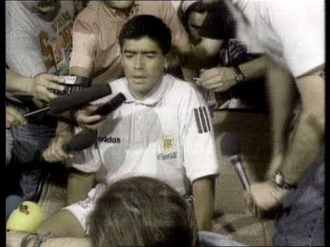 Maradona indefinate ban USA MS Diego Maradona sitting speaking as surrounded by press ZOOM IN MS Maradona speaking at pkf ZOOM IN