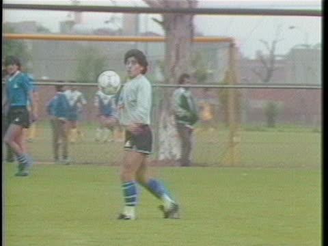 maradona on field kicking soccer ball into air - argentina stock videos & royalty-free footage