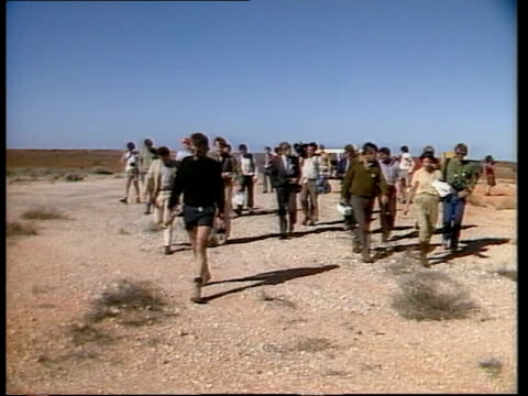 atomic test site itn great victoria desert ms senior australian politician down steps of plane to visit blast site pan ms jeep driven along to blast... - contatore geiger video stock e b–roll