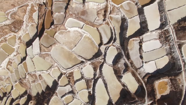 maras salt farms (salinas de maras), peru drone view - geology stock videos & royalty-free footage