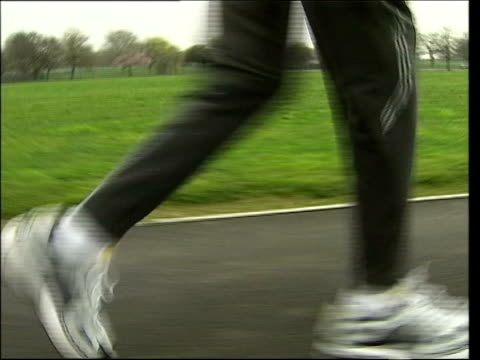 marathon runner; itn england: london: ilford: ext slow motion feet of fauja singh running along - ilford stock videos & royalty-free footage