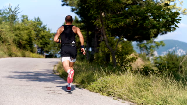 marathon runner - middle of the road stock videos & royalty-free footage