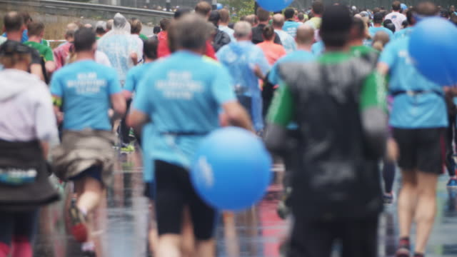 marathon runners in slow motion from behind - track event stock videos & royalty-free footage