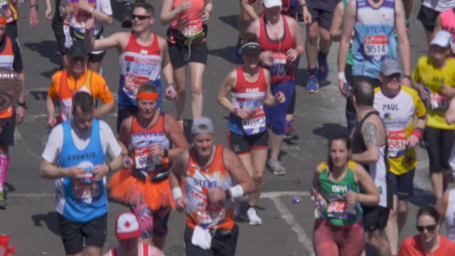 marathon runners in the city street. close-up. - charity benefit stock videos & royalty-free footage