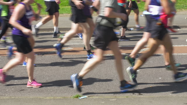 marathon runners in the city street. - charity benefit stock videos & royalty-free footage
