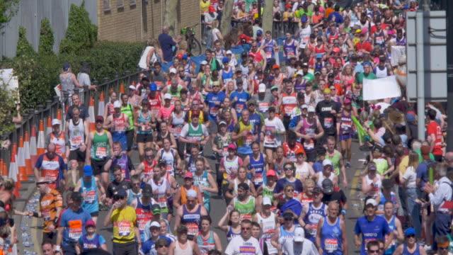 marathon runners in the city street. - london marathon stock videos & royalty-free footage