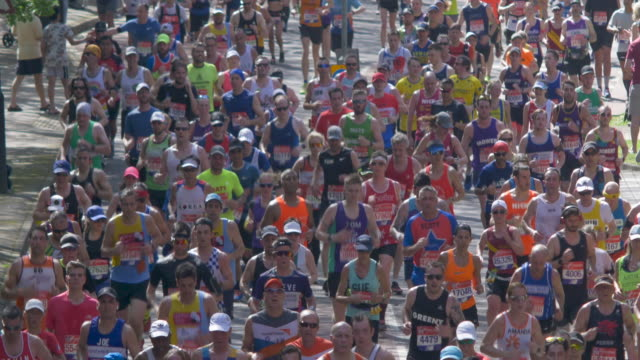 marathon runners in the city street.backlight. - london marathon stock videos & royalty-free footage