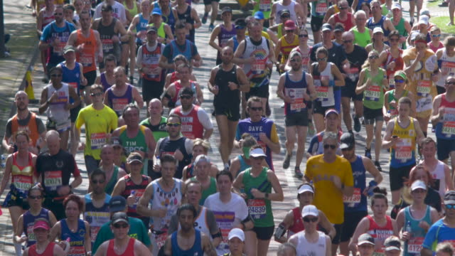 marathon runners in the city street.backlight. - marathon stock videos and b-roll footage