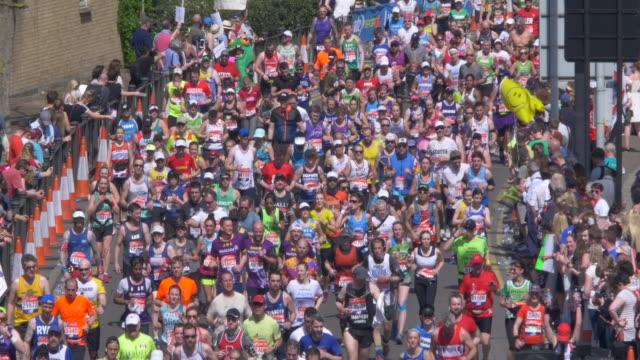 marathon runners in the hot city street. - london marathon stock videos & royalty-free footage