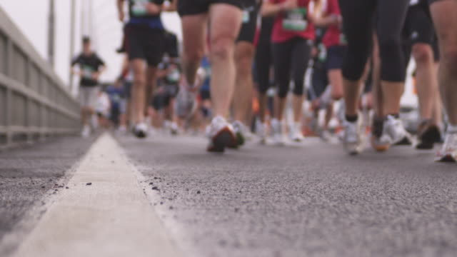 slo mo, selective focus, marathon runners, low section, auckland, new zealand - human foot stock videos and b-roll footage