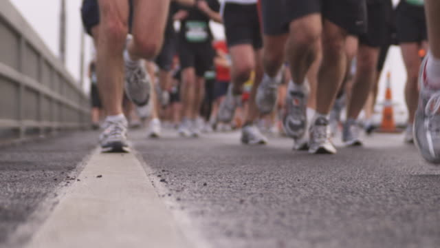 slo mo, selective focus, marathon runners, low section, auckland, new zealand - human leg stock videos and b-roll footage