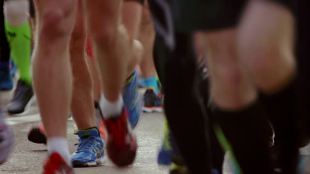 marathon running race with people feet - triathlon stock videos & royalty-free footage