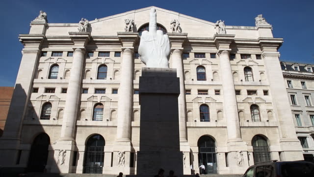 marble sculpture entitled 'l.o.v.e.' by maurizio cattelan in front of italy's stock exchange, the borsa italiana, which is part of the london stock... - italian culture stock videos & royalty-free footage