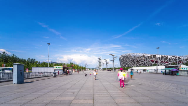 marble square and beijing nest stadium in blue sky. timelapse 4k hyperlapse - bird's nest stock videos & royalty-free footage