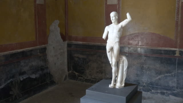 a marble statue artwork of a man with a large penis in the ancient ruins historic landmark of pompeii, italy, europe. - penis stock videos & royalty-free footage