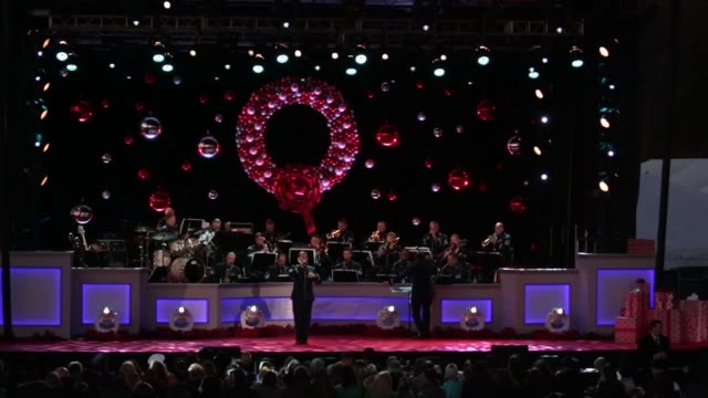 marc anthony accompanied by the airmen of note performs at the 94th annual national christmas tree lighting ceremony at the ellipse near the white... - クリスマスツリー点灯式点の映像素材/bロール