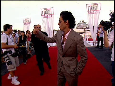 marc anthony posing for pictures, waving to the crowd and walking down the 2004 mtv video music awards red carpet. - 2004 stock videos & royalty-free footage