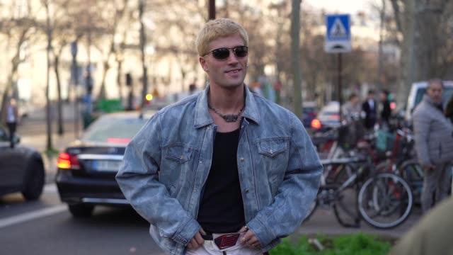 marc forne wears sunglasses, a blue denim jacket, a necklace, a black t-shirt, biker pants, black boots, outside wooyoungmi, during paris fashion... - schwarzes hemd stock-videos und b-roll-filmmaterial