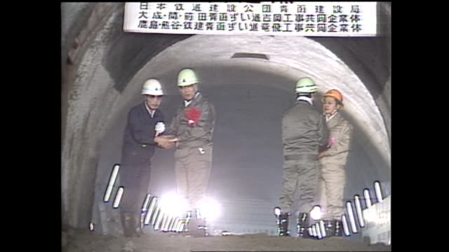 march 10 the main road of seikan tunnel was penetrated after 21yearlong difficult construction since 1964 workers and then minister of transport came... - straits stock videos and b-roll footage