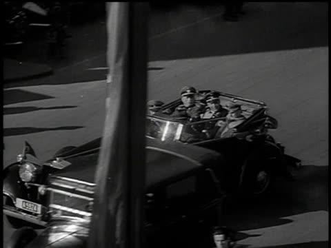 march 13, 1938 bw convertible transporting german military dignitaries through city street / vienna, austria - insignier bildbanksvideor och videomaterial från bakom kulisserna