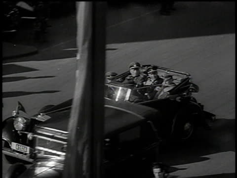 march 13 1938 bw convertible transporting german military dignitaries through city street / vienna austria - hakenkreuzfahne stock-videos und b-roll-filmmaterial