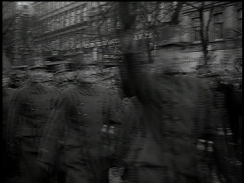 march 13 1938 bw ranks of german soldiers marching by camera some giving the hitler salute / vienna austria - hakenkreuzfahne stock-videos und b-roll-filmmaterial