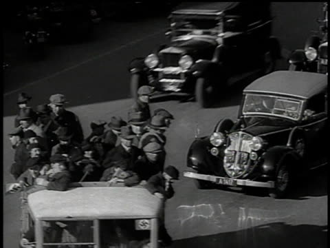 march 13, 1938 bw truck carrying civilians driving through the street / vienna, austria - 1938 bildbanksvideor och videomaterial från bakom kulisserna