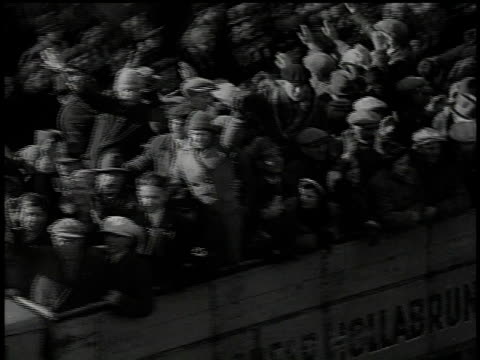 stockvideo's en b-roll-footage met march 13 1938 b/w truck carrying civilians giving the hitler salute driving past / vienna austria - 1938