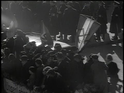 march 13, 1938 bw truck carrying civilians waving swastika flags driving through the street / vienna, austria - 1938 bildbanksvideor och videomaterial från bakom kulisserna