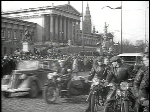 march 13, 1938 cars and motorcycles with sidecars driving down street, rathaus and parliament building in background / vienna, austria - sidecar stock videos & royalty-free footage