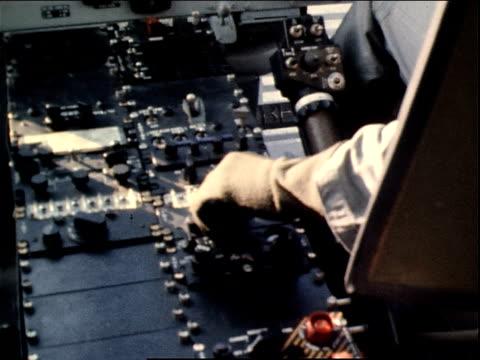 March 13 1971 HA pilot's hand adjusting controls in a gunship flying at Tan Son Nhut Air Base / Saigon Vietnam