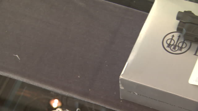 march 13, 2008 display shelf holding smith & wesson pistol / united states - 銃器店点の映像素材/bロール