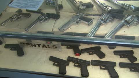 march 13, 2008 handguns lying in display counter / united states - 銃器店点の映像素材/bロール