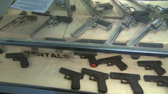 stockvideo's en b-roll-footage met march 13 2008 pan handguns lying in display counter / united states - vuurwapenwinkel