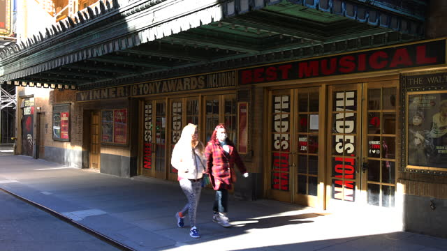 march 13: after one year epidemic of coronavirus disease, the number of visitors has still reduced around the walter kerr theatre in saturday... - pandemic illness stock videos & royalty-free footage