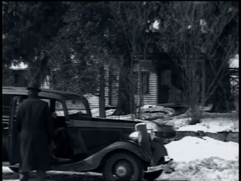 march 1935 car pulling up in front of a house, driver and passenger getting out and going inside / wilton, connecticut, united states - 1935 stock videos & royalty-free footage