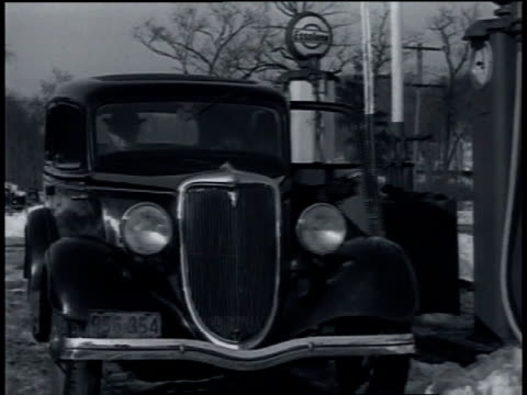 march 1935 car pulls up to gas pump and man gets out and checks oil / wilton, connecticut, united states - 1935 stock videos & royalty-free footage