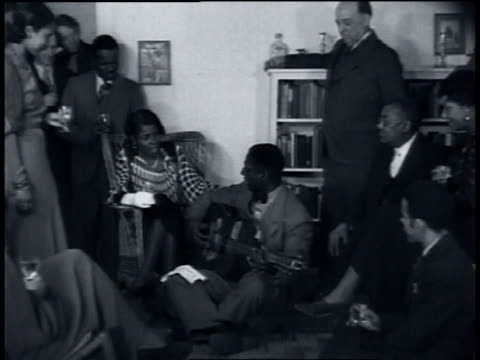 march 1935 ws leadbelly singing good night irene for a group of people at a party / united states - blues stock videos & royalty-free footage