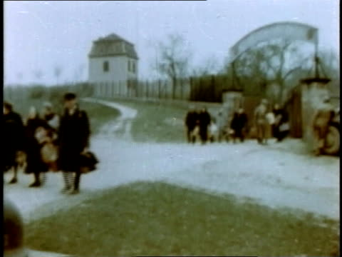 vídeos de stock, filmes e b-roll de march 1945 montage refugees pushing carts walking and riding bicycles leaving town / germany - 1945