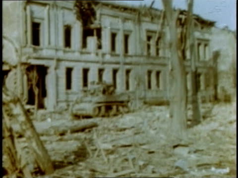 march 1945 montage tanks driving through rubble-filled streets of destroyed town / germany - rubble stock-videos und b-roll-filmmaterial